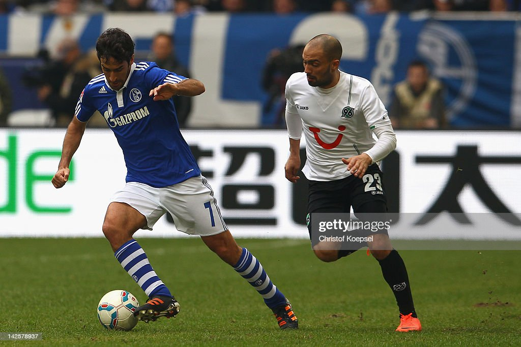 Sofian Chahed of Hannover challenges Raul Gonzalez of Schalke during the Bundesliga match between FC Schalke 04 and Hanover 96 at Veltins Arena on...