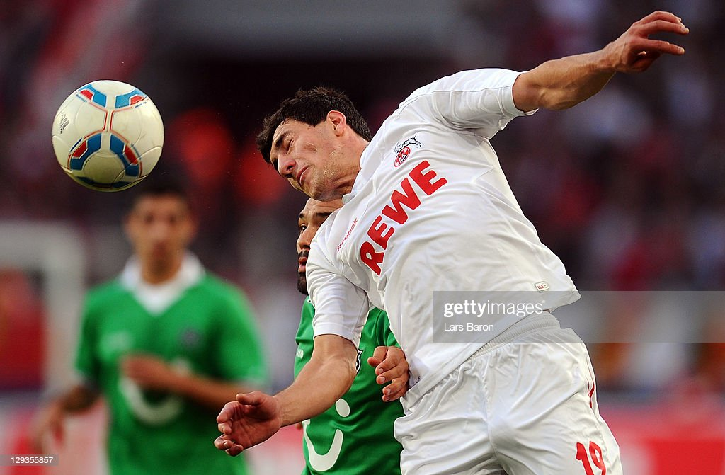Sofian Chahed of Hannover goes up for a header with Mato Jajalo of Koeln during the Bundesliga match between 1 FC Koeln and Hannover 96 at...