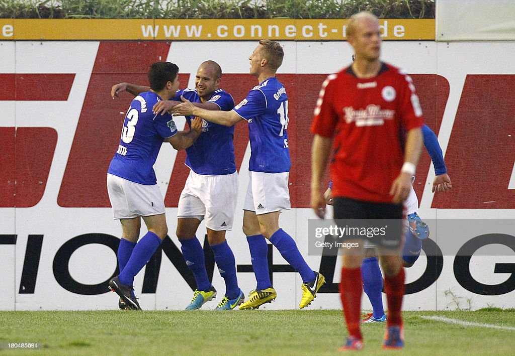 Sofian Chahed of Lotte celebrates after scoring his team's second goal with team mates during the Regionalliga West match between Sportfreunde Lotte and Rot Weiss Oberhausen at ConnectM-Arena on September 13, 2013 in Lotte, Germany.