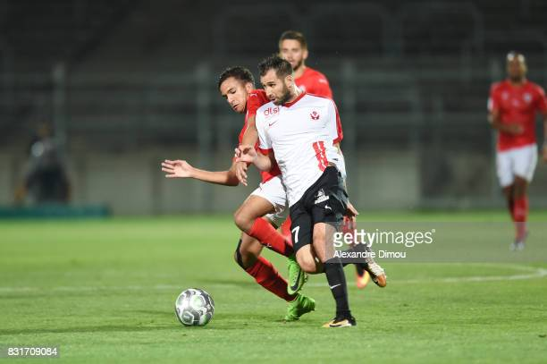 Sofiane Alakouch of Nimes and Antony Robic of Nancy during the Ligue 2 match between Nimes Olympique and As Nancy Lorraine at Stade des Costieres on...