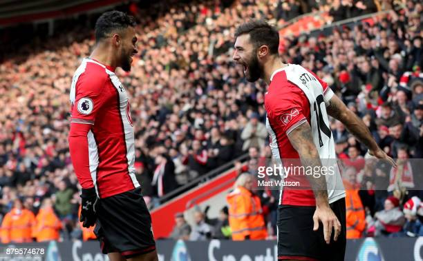 Sofiane Boufal celebrates with Charlie Austin during the Premier League match between Southampton and Everton at St Mary's Stadium on November 26...