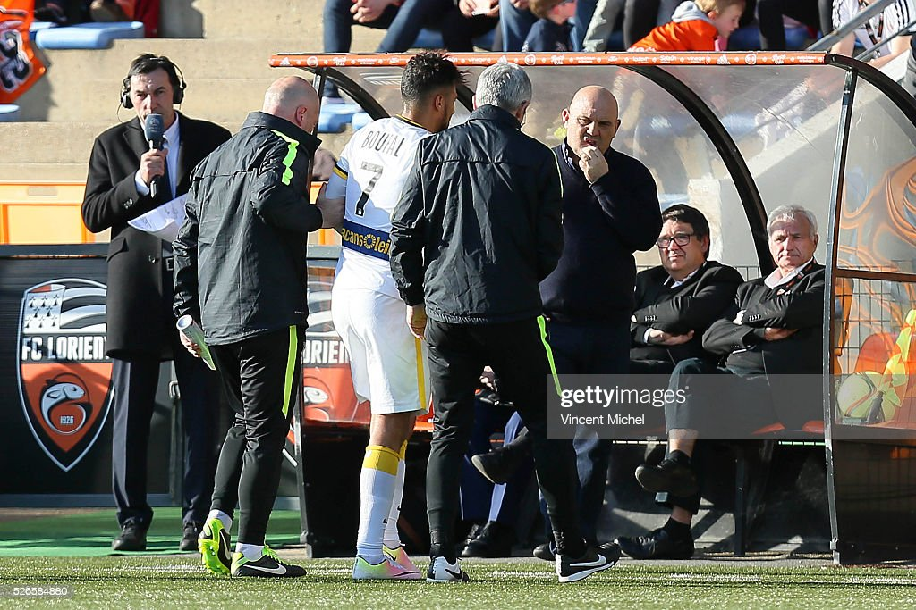 Sofiane Boufal of Lille injured and coach of Lille Frederic Antonetti during the French Ligue 1 match between Fc Lorient and Lille OSC at Stade du Moustoir on April 30, 2016 in Lorient, France.