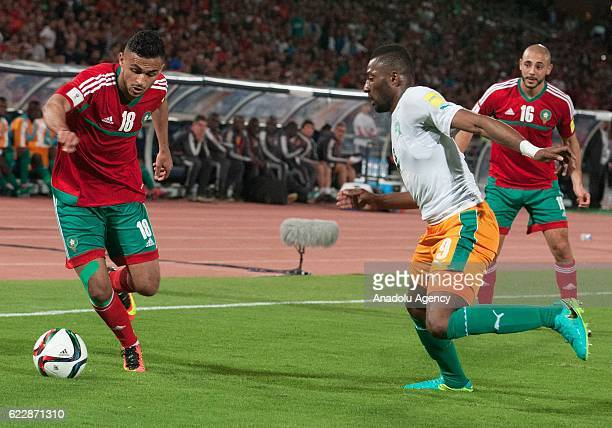 Sofiane Boufal of Morocco vies with Wilfried Kanon of Ivory Coast receives a treatment during the 2018 World Cup qualifying Group C football match...