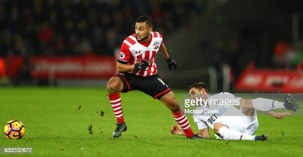 Sofiane Boufal of Southampton and Angel Rangel of Swansea City compete for the ball during the Premier League match between Swansea City and...