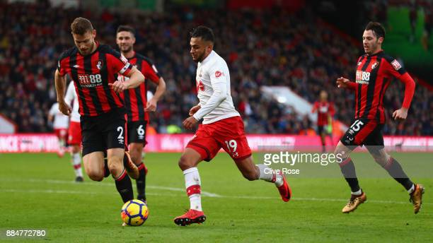 Sofiane Boufal of Southampton attempts to get past Simon Francis of AFC Bournemouth during the Premier League match between AFC Bournemouth and...