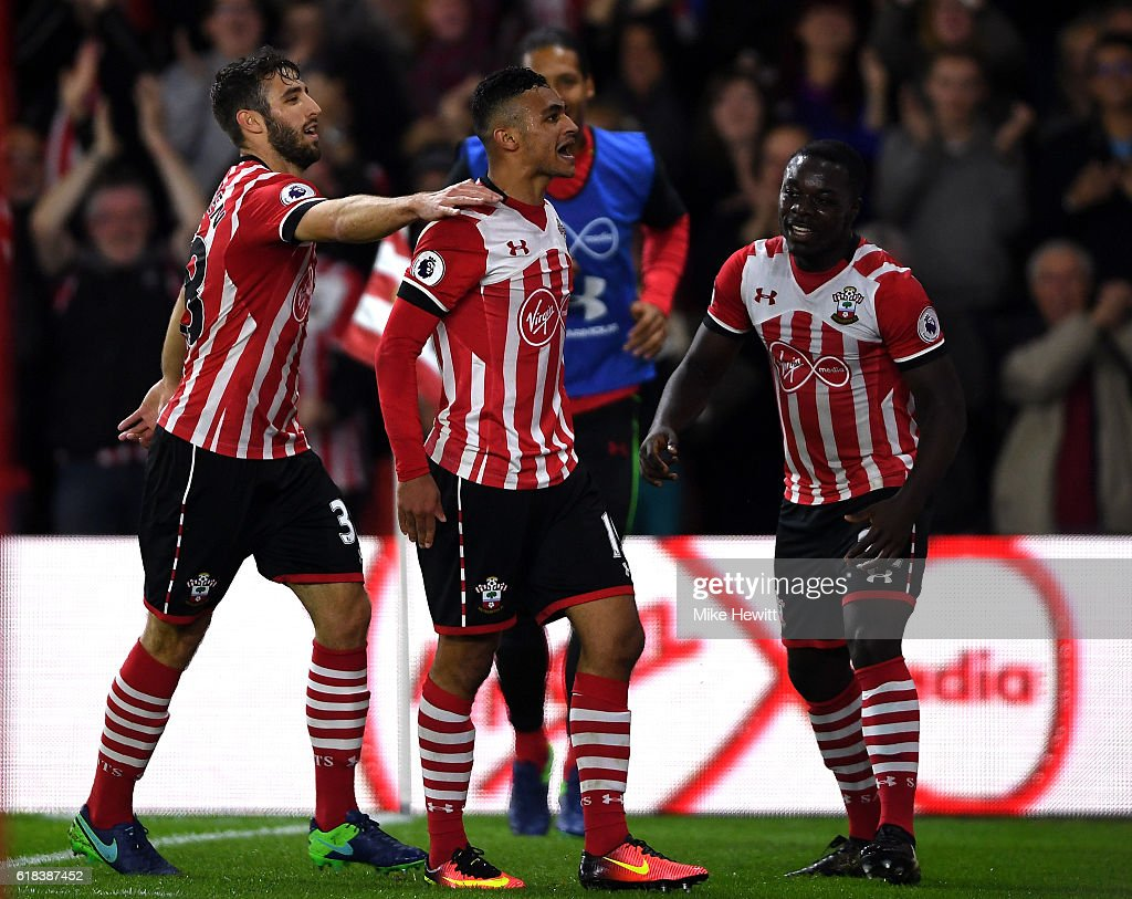 Sofiane Boufal of Southampton (C) celebrates scoring his sides first goal with Sam McQueen of Southampton (L) and Olufela Olomola of Southampton (R) during the EFL Cup fourth round match between Southampton and Sunderland at St Mary's Stadium on October 26, 2016 in Southampton, England.
