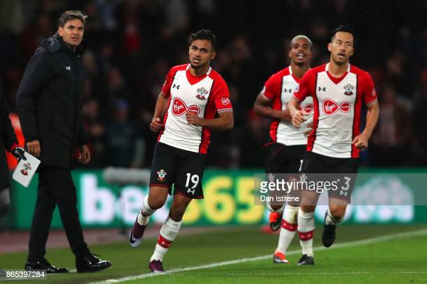 Sofiane Boufal of Southampton celebrates with his manager Mauricio Pellegrino and teammates after scoring the winning goal during the Premier League...