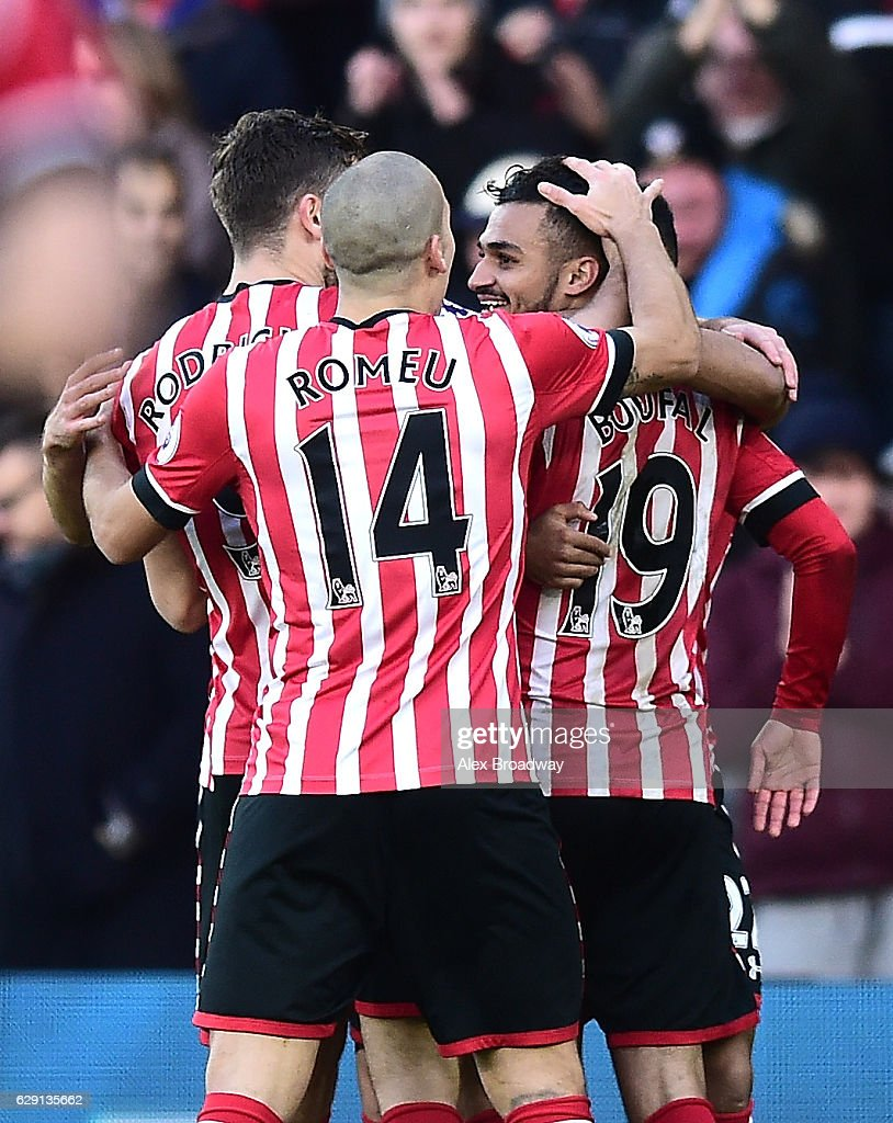 Sofiane Boufal of Southampton celebrates with team mates after he scores his side's first goal during the Premier League match between Southampton and Middlesbrough at St Mary's Stadium on December 11, 2016 in Southampton, England.