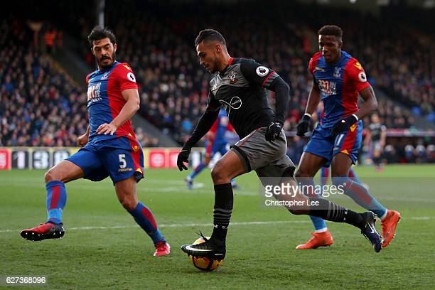 Sofiane Boufal of Southampton controls the ball under pressure of James Tomkins and Wilfried Zaha of Crystal Palace during the Premier League match...