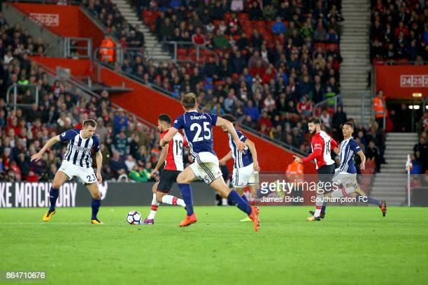 Sofiane Boufal of Southampton FC takes on Gareth Mcauley of West Bromwhich Albion during the Premier League match between Southampton and West...