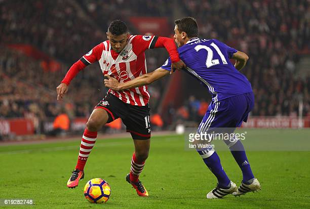 Sofiane Boufal of Southampton has his shirt pulled by Nemanja Matic of Chelsea during the Premier League match between Southampton and Chelsea at St...