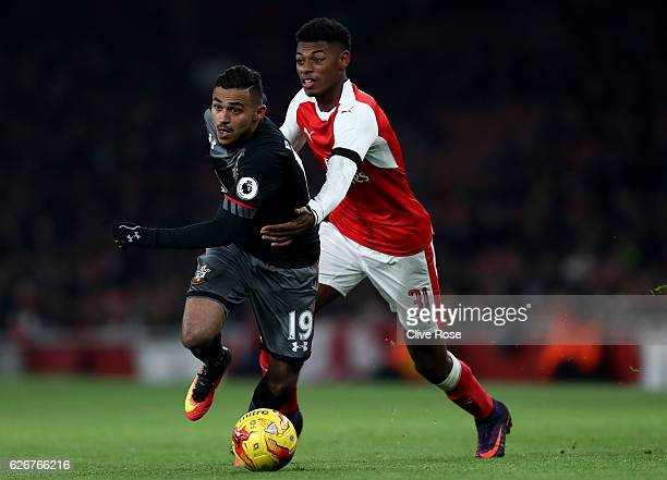 Sofiane Boufal of Southampton holds off pressure from Jeff ReineAdelaide of Arsenal during the EFL Cup quarter final match between Arsenal and...