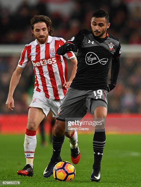 Sofiane Boufal of Southampton is put under pressure from Joe Allen of Stoke City during the Premier League match between Stoke City and Southampton...