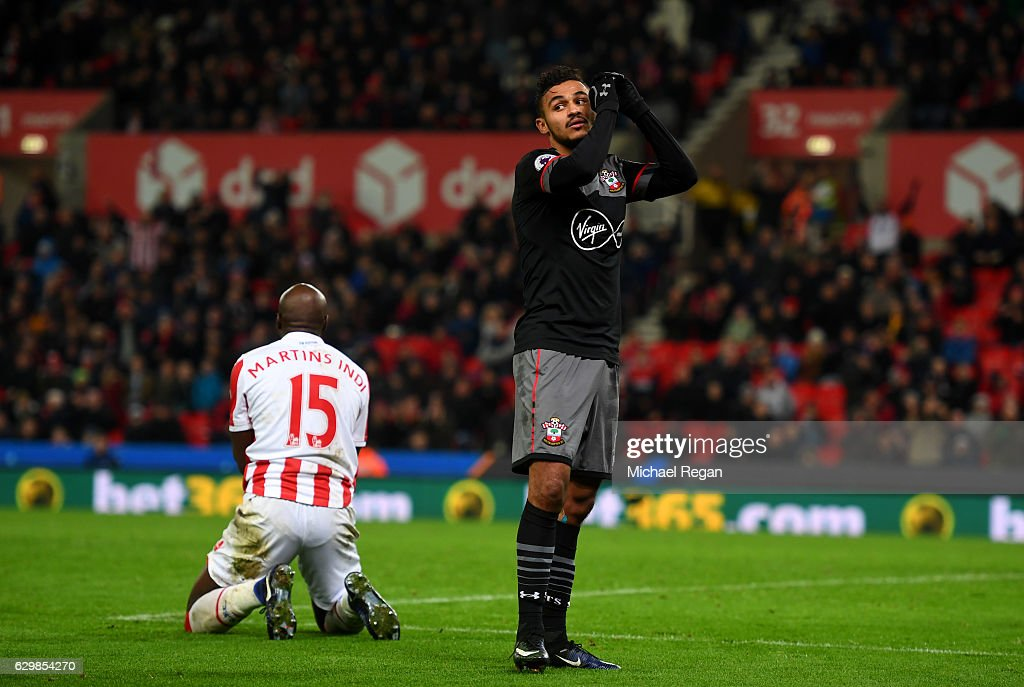 Sofiane Boufal of Southampton (R) reacts during the Premier League match between Stoke City and Southampton at Bet365 Stadium on December 14, 2016 in Stoke on Trent, England.