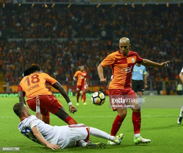 Sofiane Feghouli and Gomis of Galatasaray in action against Baris Basdas of Kardemir Karabukspor during the Turkish Super Lig soccer match between...