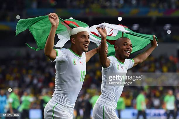 Sofiane Feghouli and Yacine Brahimi of Algeria celebrate after a 11 draw during the 2014 FIFA World Cup Brazil Group H match between Algeria and...