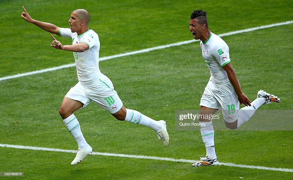 <a gi-track='captionPersonalityLinkClicked' href=/galleries/search?phrase=Sofiane+Feghouli&family=editorial&specificpeople=5485378 ng-click='$event.stopPropagation()'>Sofiane Feghouli</a> of Algeria and Saphir Taider celebrate their team's first goal after a penalty kick during the 2014 FIFA World Cup Brazil Group H match between Belgium and Algeria at Estadio Mineirao on June 17, 2014 in Belo Horizonte, Brazil.