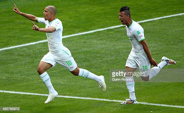 Sofiane Feghouli of Algeria and Saphir Taider celebrate their team's first goal after a penalty kick during the 2014 FIFA World Cup Brazil Group H...