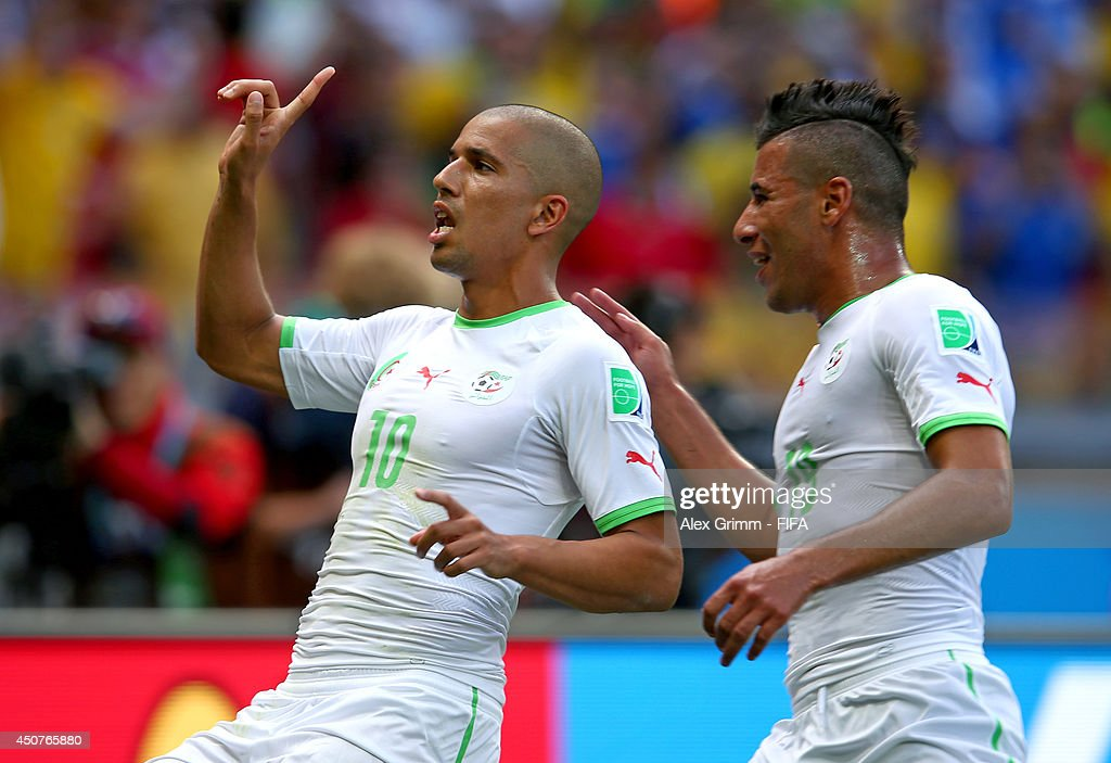 <a gi-track='captionPersonalityLinkClicked' href=/galleries/search?phrase=Sofiane+Feghouli&family=editorial&specificpeople=5485378 ng-click='$event.stopPropagation()'>Sofiane Feghouli</a> of Algeria celebrates after scoring the team's first goal from the penalty spot during the 2014 FIFA World Cup Brazil Group H match between Belgium and Algeria at Estadio Mineirao on June 17, 2014 in Belo Horizonte, Brazil.