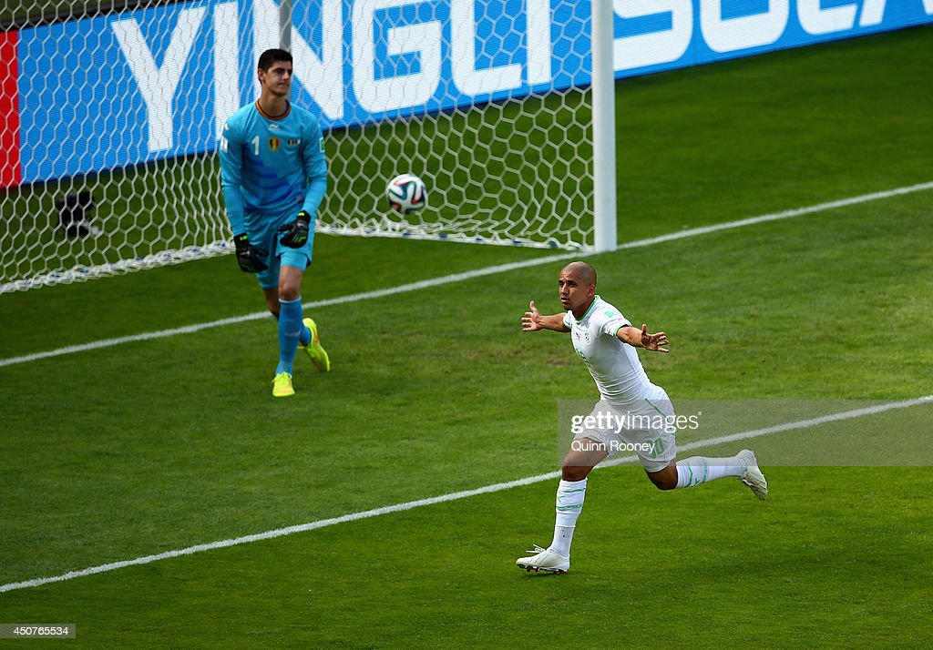 <a gi-track='captionPersonalityLinkClicked' href=/galleries/search?phrase=Sofiane+Feghouli&family=editorial&specificpeople=5485378 ng-click='$event.stopPropagation()'>Sofiane Feghouli</a> of Algeria celebrates scoring his team's first goal on a penalty kick past <a gi-track='captionPersonalityLinkClicked' href=/galleries/search?phrase=Thibaut+Courtois&family=editorial&specificpeople=7126410 ng-click='$event.stopPropagation()'>Thibaut Courtois</a> of Belgium during the 2014 FIFA World Cup Brazil Group H match between Belgium and Algeria at Estadio Mineirao on June 17, 2014 in Belo Horizonte, Brazil.