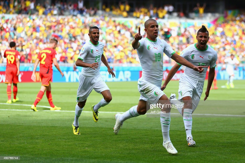 <a gi-track='captionPersonalityLinkClicked' href=/galleries/search?phrase=Sofiane+Feghouli&family=editorial&specificpeople=5485378 ng-click='$event.stopPropagation()'>Sofiane Feghouli</a> of Algeria celebrates scoring his team's first goal after a penalty kick during the 2014 FIFA World Cup Brazil Group H match between Belgium and Algeria at Estadio Mineirao on June 17, 2014 in Belo Horizonte, Brazil.