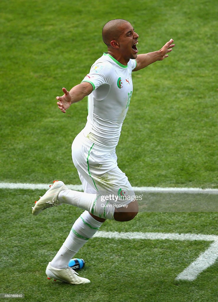 <a gi-track='captionPersonalityLinkClicked' href=/galleries/search?phrase=Sofiane+Feghouli&family=editorial&specificpeople=5485378 ng-click='$event.stopPropagation()'>Sofiane Feghouli</a> of Algeria celebrates scoring his team's first goal on a penalty kick during the 2014 FIFA World Cup Brazil Group H match between Belgium and Algeria at Estadio Mineirao on June 17, 2014 in Belo Horizonte, Brazil.