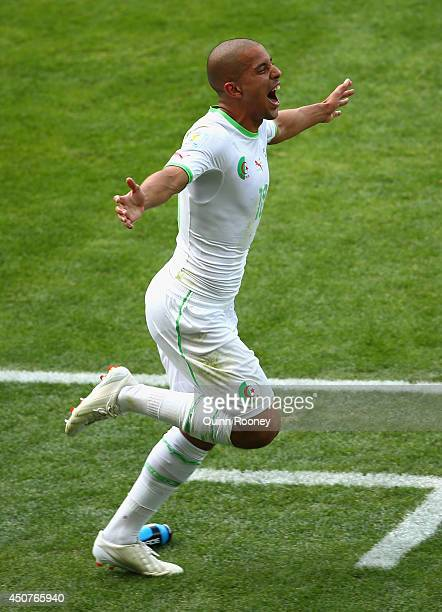Sofiane Feghouli of Algeria celebrates scoring his team's first goal on a penalty kick during the 2014 FIFA World Cup Brazil Group H match between...
