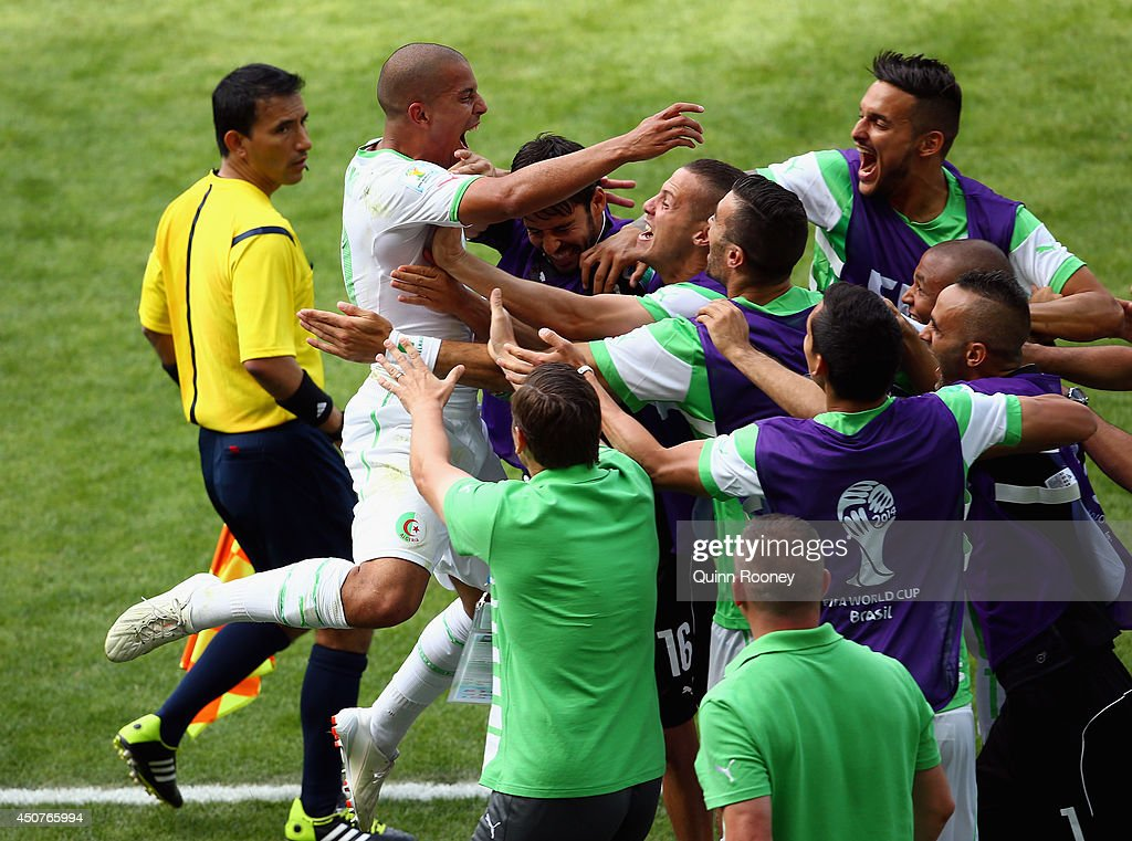 <a gi-track='captionPersonalityLinkClicked' href=/galleries/search?phrase=Sofiane+Feghouli&family=editorial&specificpeople=5485378 ng-click='$event.stopPropagation()'>Sofiane Feghouli</a> of Algeria celebrates with his teammates after scoring his team's first goal on a penalty kick during the 2014 FIFA World Cup Brazil Group H match between Belgium and Algeria at Estadio Mineirao on June 17, 2014 in Belo Horizonte, Brazil.