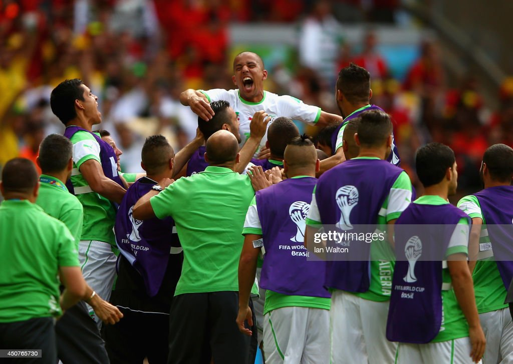 <a gi-track='captionPersonalityLinkClicked' href=/galleries/search?phrase=Sofiane+Feghouli&family=editorial&specificpeople=5485378 ng-click='$event.stopPropagation()'>Sofiane Feghouli</a> of Algeria (C) celebrates with teammates after scoring his team's first goal on a penalty kick during the 2014 FIFA World Cup Brazil Group H match between Belgium and Algeria at Estadio Mineirao on June 17, 2014 in Belo Horizonte, Brazil.