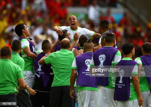 Sofiane Feghouli of Algeria celebrates with teammates after scoring his team's first goal on a penalty kick during the 2014 FIFA World Cup Brazil...