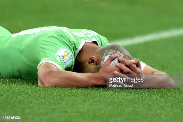 Sofiane Feghouli of Algeria reacts during the 2014 FIFA World Cup Brazil Round of 16 match between Germany and Algeria at Estadio BeiraRio on June 30...