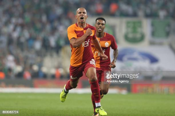 Sofiane Feghouli of Galatasaray celebrates with his teammate Rodrigues after scoring a goal during the Turkish Super Lig week 6 soccer match between...