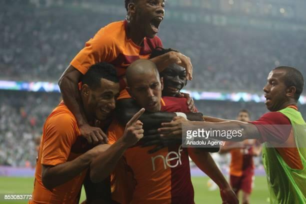 Sofiane Feghouli of Galatasaray celebrates with his teammates after scoring a goal during the Turkish Super Lig week 6 soccer match between Bursaspor...