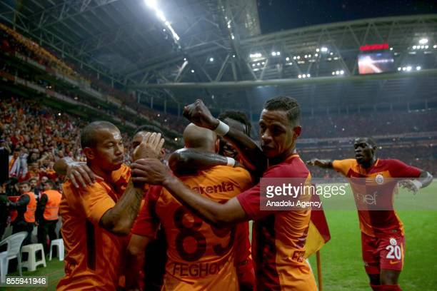 Sofiane Feghouli of Galatasaray celebrates with his teammates after scoring a goal during the Turkish Super Lig soccer match between Galatasaray and...