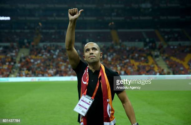 Sofiane Feghouli of Galatasaray greets the fans ahead of a Turkish Spor Toto Super Lig soccer match between Galatasaray and Kayserispor at Turk...