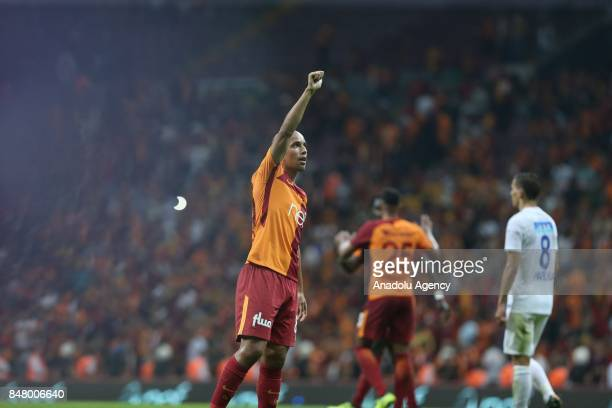 Sofiane Feghouli of Galatasaray greets the supporters after the fifth week of the Turkish Super Lig soccer match between Galatasaray and Kasimpasa at...