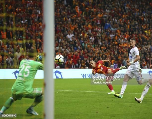 Sofiane Feghouli of Galatasaray in action against Baris Basdas of Kardemir Karabukspor during the Turkish Super Lig soccer match between Galatasaray...