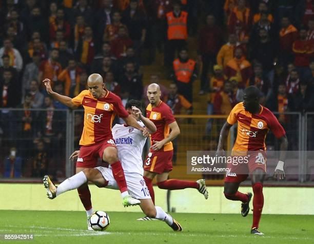 Sofiane Feghouli of Galatasaray in action against Cristian Tanase of Kardemir Karabukspor during the Turkish Super Lig soccer match between...
