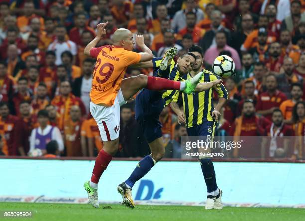 Sofiane Feghouli of Galatasaray in action against Josef De Souza of Fenerbahce during a Turkish Super Lig match between Galatasaray and Fenerbahce at...