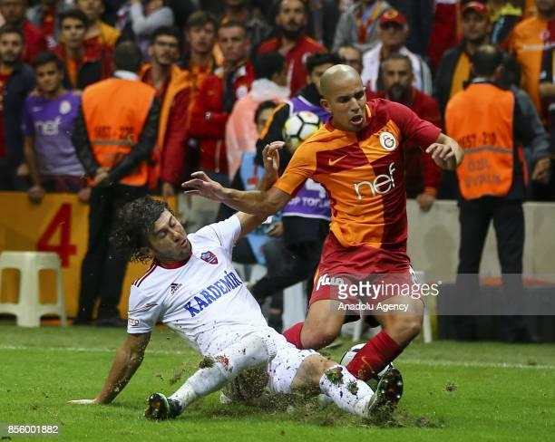 Sofiane Feghouli of Galatasaray in action against Kerim Zengin of Kardemir Karabukspor during the Turkish Super Lig soccer match between Galatasaray...