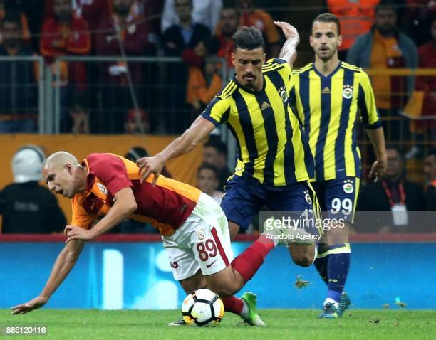 Sofiane Feghouli of Galatasaray in action against Nabil Dirar of Fenerbahce during a Turkish Super Lig match between Galatasaray and Fenerbahce at...