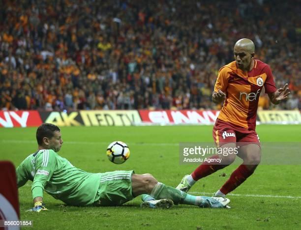 Sofiane Feghouli of Galatasaray in action against Oleksandr Rybka of Kardemir Karabukspor during the Turkish Super Lig soccer match between...