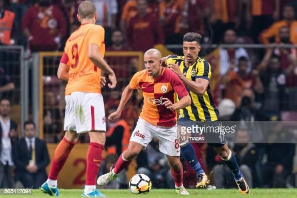 Sofiane Feghouli of Galatasaray SK Nabil Dirar of Fenerbahce SK during the Turkish Spor Toto Super Lig football match between Galatasaray SK and...