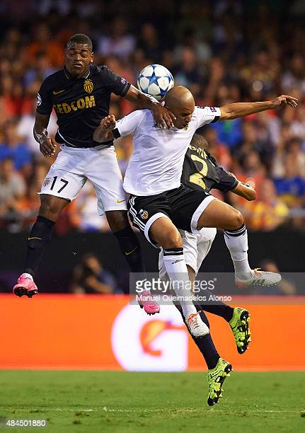 Sofiane Feghouli of Valencia battle for the ball with Ivan Cavaleiro of Monaco during the UEFA Champions League Qualifying Round PlayOff First Leg...