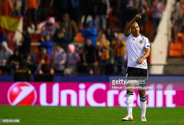 Sofiane Feghouli of Valencia celebrates scoring his team's first goal during the UEFA Champions League Group H match between Valencia CF and KAA Gent...