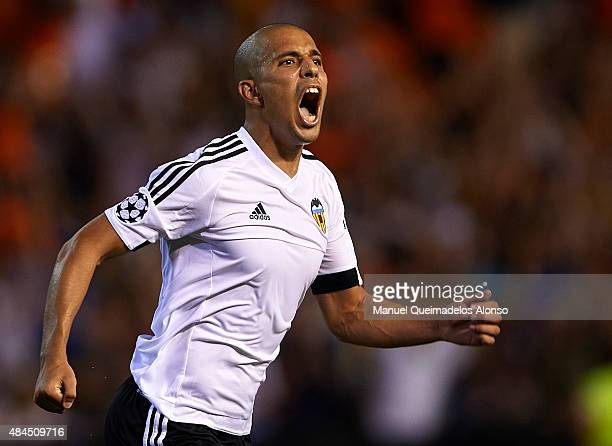 Sofiane Feghouli of Valencia celebrates scoring his team's third goal during the UEFA Champions League Qualifying Round Play Off First Leg match...