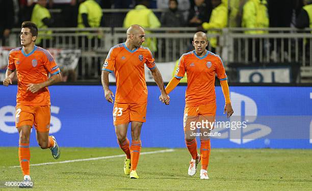 Sofiane Feghouli of Valencia CF celebrates his goal with Aymen Abdennour of Valencia CF during the UEFA Champions league match between Olympic...