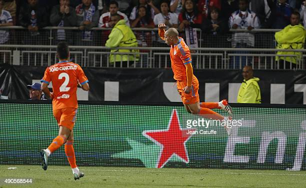 Sofiane Feghouli of Valencia CF celebrates scoring a goal for his team during the UEFA Champions league match between Olympique Lyonnais and Valencia...