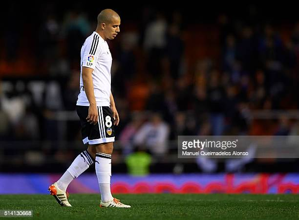 Sofiane Feghouli of Valencia leaves the pitch after his team's 13 defeat in the La Liga match between Valencia CF and Atletico de Madrid at Estadi de...