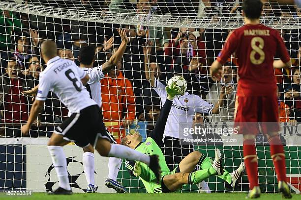 Sofiane Feghouli of Valencia scores the opening goal against Manuel Neuer keeper of Muenchen during the UEFA Champions League group F match between...